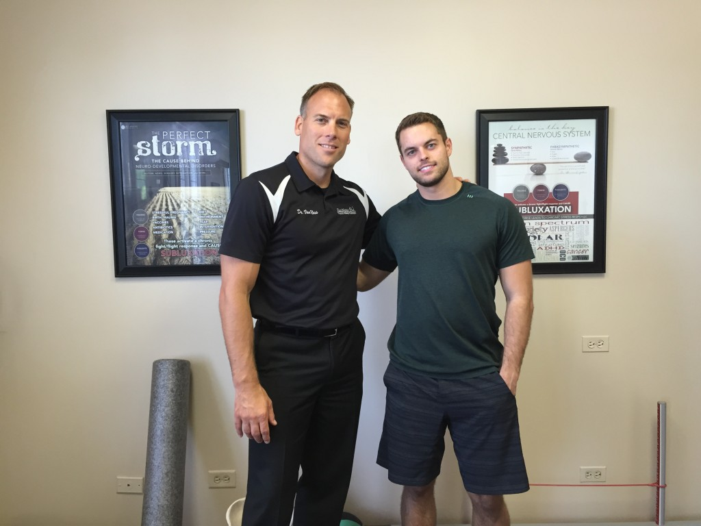 image of the best Barrington chiropractor, Dr. Jason Van Ness, with a client